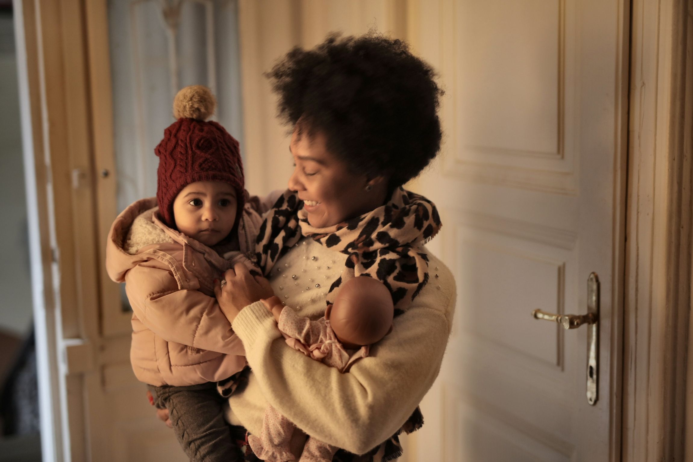 African-American mother and baby dressed in winter clothes.